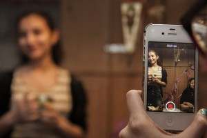 Featured Image. A girl recording herself with a cellphone